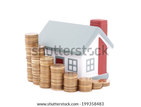 House with stack of coins. Clipping path included. - stock photo