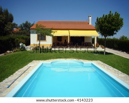 house with swimming pool - stock photo