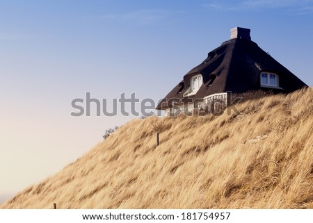 House with thatched roof on the island of Sylt, Germany - stock photo