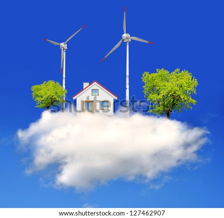 house with wind turbines on the cloud - stock photo