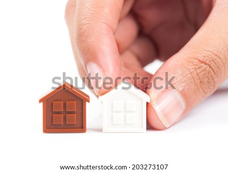House Wooden in hand - isolated on white background - stock photo