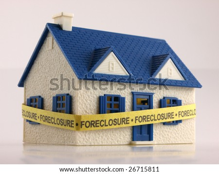 House wrapped with Foreclosure tape ground view - stock photo