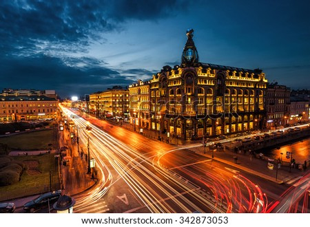 House Zinger on Nevsky Prospekt in St. Petersburg at night illumination with blured traffic on road - stock photo