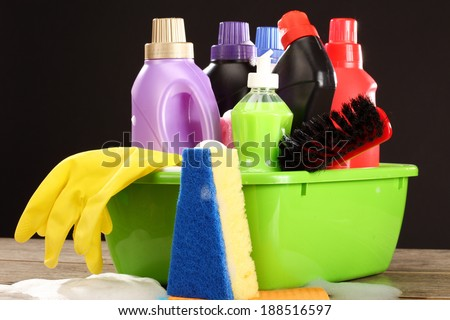 Household chemical goods for cleaning on black - stock photo