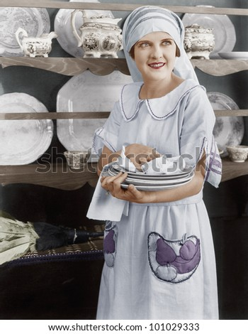 Housekeeper drying plates - stock photo