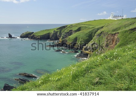 Housel Bay and Lizard Lighthouse and Lion's Den, Lizard Point, Cornwall Viewed from Pen Olver - stock photo
