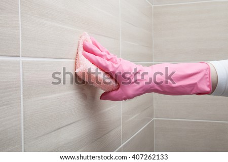 Housemaid cleaning a bathroom, closeup shot - stock photo