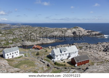 Houses along coastline near Lindesnes lighthouse (South Cape, Vest-Agder, Norway) - stock photo
