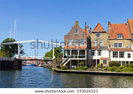 Houses and a draw-bridge in Enkhuizen, The Netherlands. The city was once one of the harbour-towns of the VOC.  - stock photo