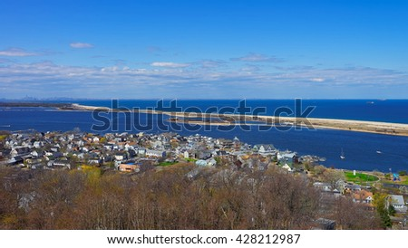 Houses and Atlantic Ocean shore at Sandy Hook with a view on NYC. View from light house. Sandy Hook is in New Jersey, USA - stock photo