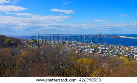 Houses and Atlantic Ocean shore at Sandy Hook with a view to NYC. View from light house. Sandy Hook is in New Jersey, USA - stock photo