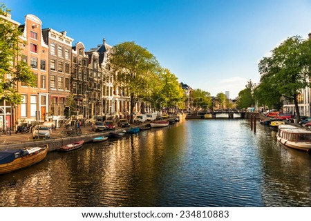 Houses and Boats on Amsterdam Canal - stock photo