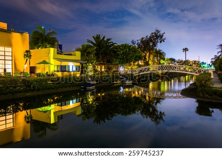 Houses and bridge along the Venice Canals at night, in Venice Beach, Los Angeles, California. - stock photo