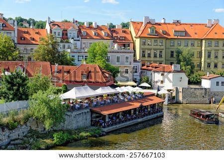 Houses and restaurants on the right bank of the river Vltava in Prague, Czech Republic. - stock photo