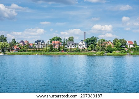 Houses by a river canal - stock photo