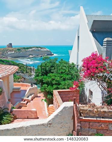 houses by Sardinia coast on a summer day - stock photo
