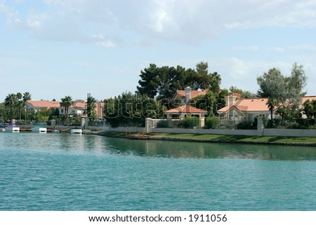 Houses by the beautiful lake - stock photo