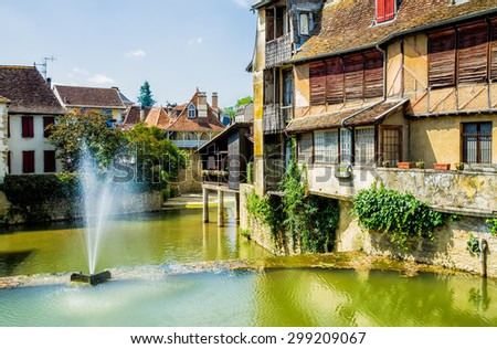Houses in the French town of Salies de Bearn - stock photo