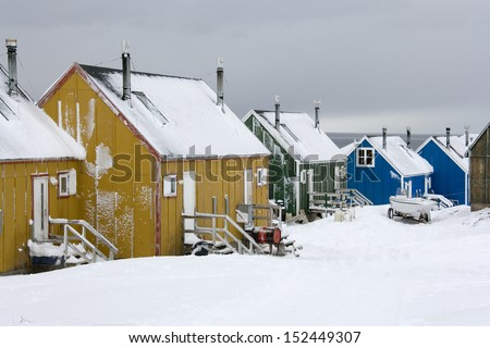 Houses in the town of Ittoqqortoormiit (pop. 551) at the entrance to Scoresbysund in eastern Greenland - stock photo