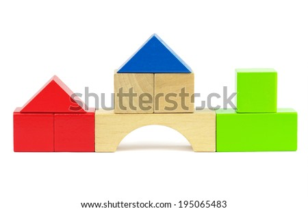 Houses made from toy wooden colorful building blocks on a white background  - stock photo