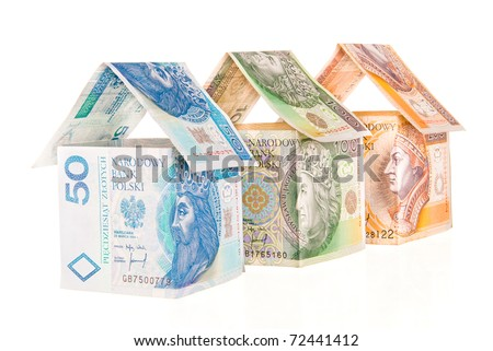 Houses made of money - stock photo