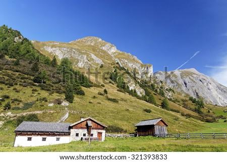 Houses near Grosglockner peak,Austria September 2015. - stock photo