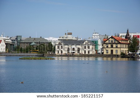 Houses near the lake  in the center of Reykjavik on a sunny summer day, Iceland - stock photo