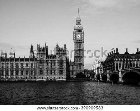Houses of Parliament aka Westminster Palace in London, UK - in black and white, dark key - stock photo