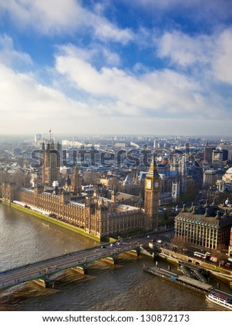 Houses of Parliament and Westminster bridge in London - stock photo