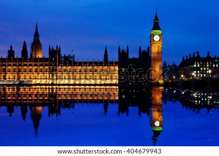 Houses of Parliament at dusk and their reflection in the Thames - stock photo