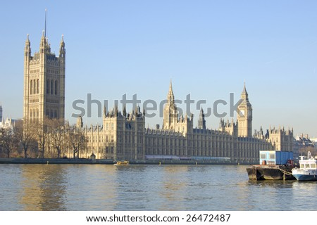 Houses of parliament from the south bank of the River Thames in London, England - stock photo