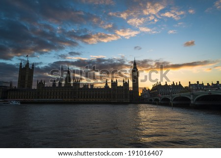 Houses of Parliament, London - silhouette against sunset sky - stock photo