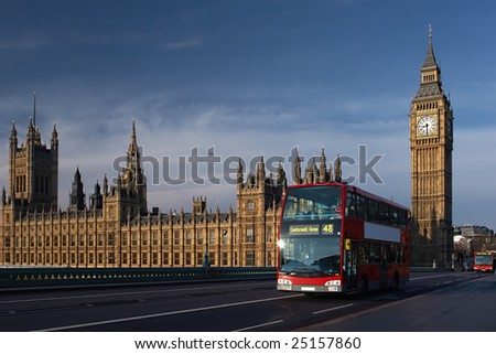 Houses of Parliament with Big Ben tower and red bus in London - stock photo