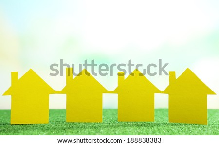 Houses on grass on natural background - stock photo