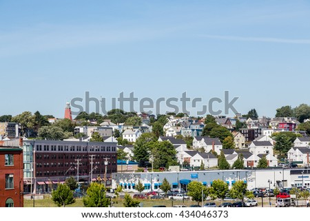 Houses up Hill in Portland Maine from Sea - stock photo