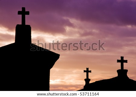 houses with crosses in purple sky overcast - stock photo