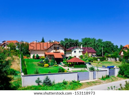 Houses with red roof in village in Slovakia at sunny day - stock photo