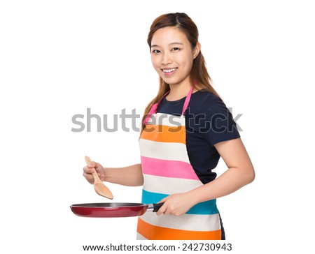 Housewife cooking with pan - stock photo