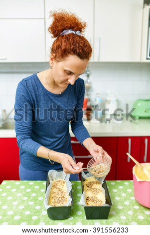 Housewife making a sweet pastry for dessert at home - stock photo
