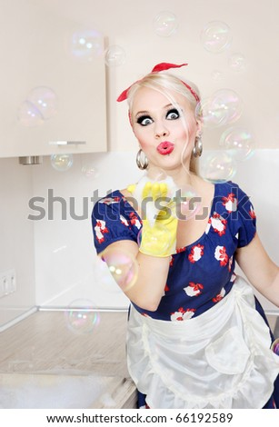 Housewife playing with soap bubbles, similar available in my portfolio - stock photo