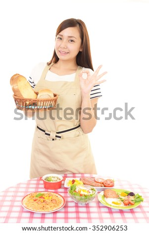 Housewife who enjoys cooking - stock photo