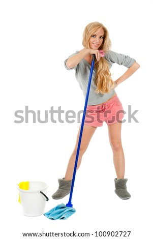 housewife with bucket and mop - stock photo