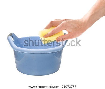 Housework. Hand with cleaning sponge and laundering wash basin isolated on white background - stock photo