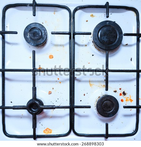 Housework, hygiene and cleaning concept. Dirt at home. Dirty filthy gas stove in kitchen - stock photo