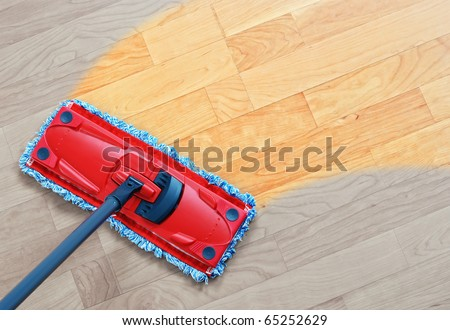 Housework - sweeper wet mop on laminate floors. - stock photo