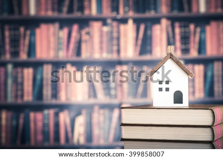 Housing and knowledge - stock photo