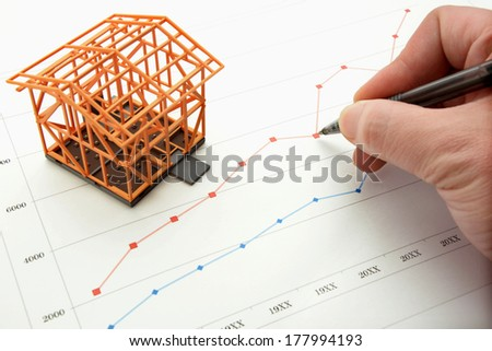 Housing market concept and graph - stock photo