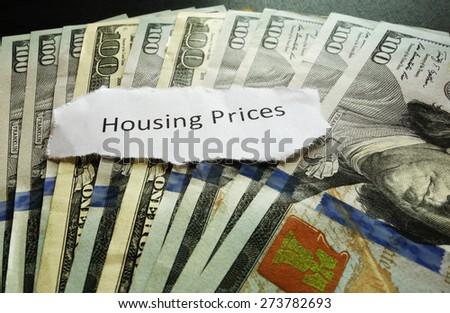 Housing Prices newspaper headline on money                                - stock photo