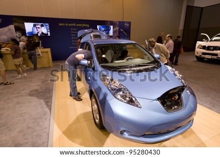 HOUSTON - JANUARY 28: The Nissan Leaf Electric car at the Houston International Auto Show on January 28, 2012 in Houston, Texas. - stock photo