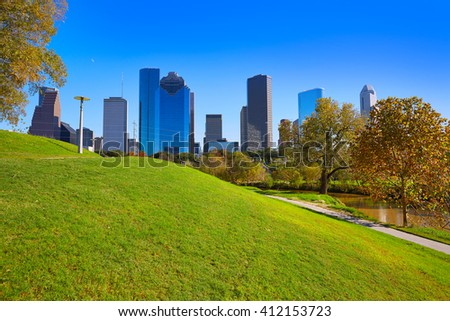 Houston skyline in sunny day from park grass of Texas USA - stock photo